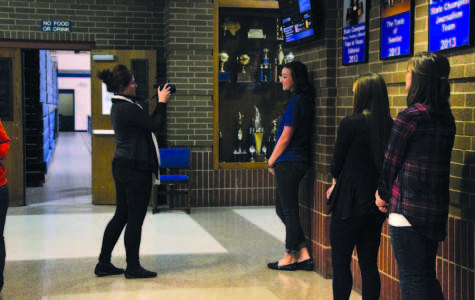 Angela Houston, Lindale News and Times reporter, taking pictures of Coronation duchess and queen nominees.