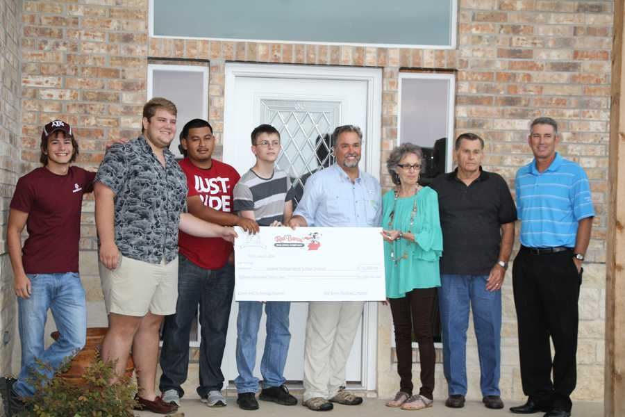 (l-r) Students-- Josh Moore, Ethan Gott, Asael Chavez, Ryan Clayton, Red Baron President-- Jerry Alexander, Homeowners-- Connie Orvig, Norman Orvig, and Superintendent Stan Surratt