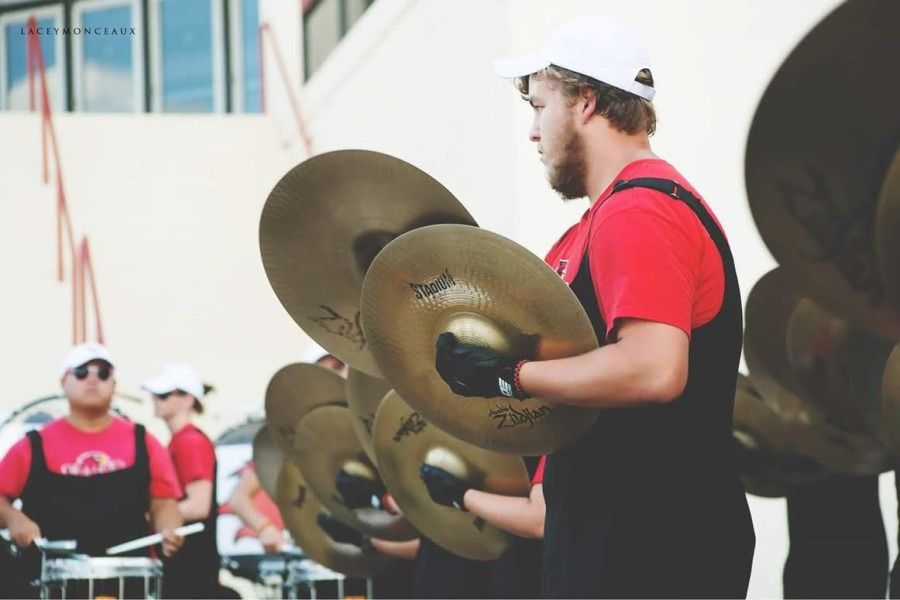 Tyler Burkham performs with the Lamar University Marching band during his freshman year at college