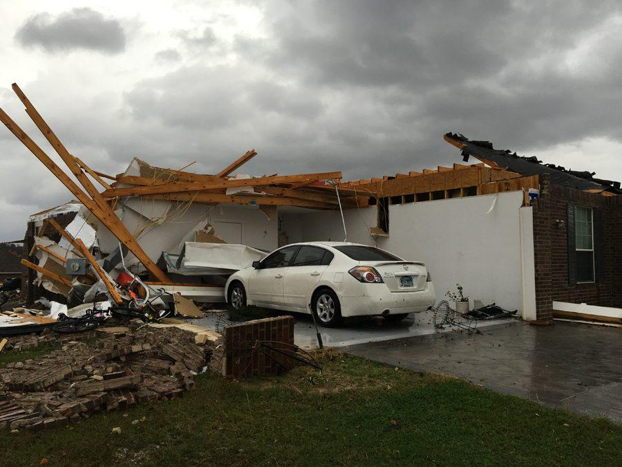 Rain continues to fall after the December tornado damages student Avery McMurrays home.