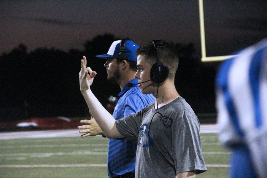 Matt Sandlin gives signals during the Van game