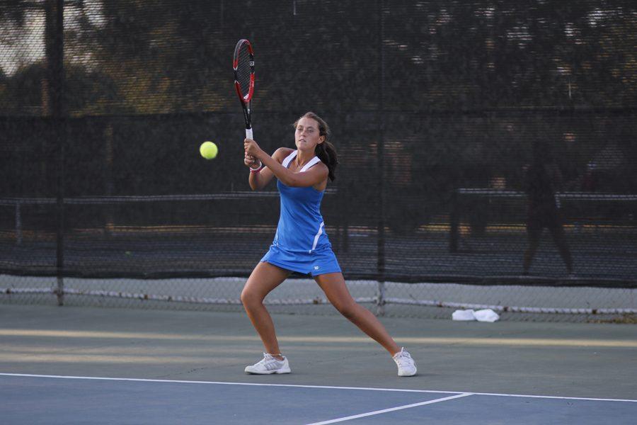Anna Self swings for varsity