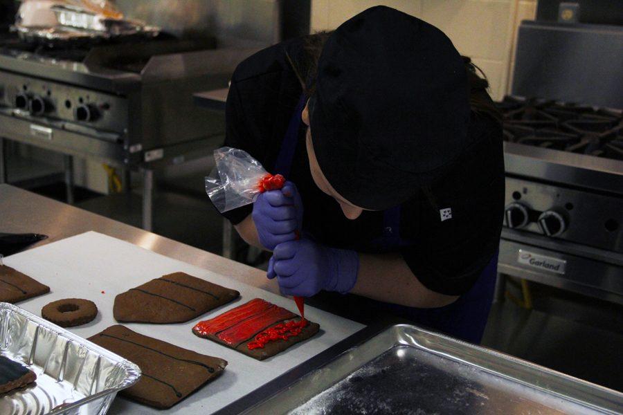 Junior Scarlett Blackburn ices her gingerbread, preparing for the contest.