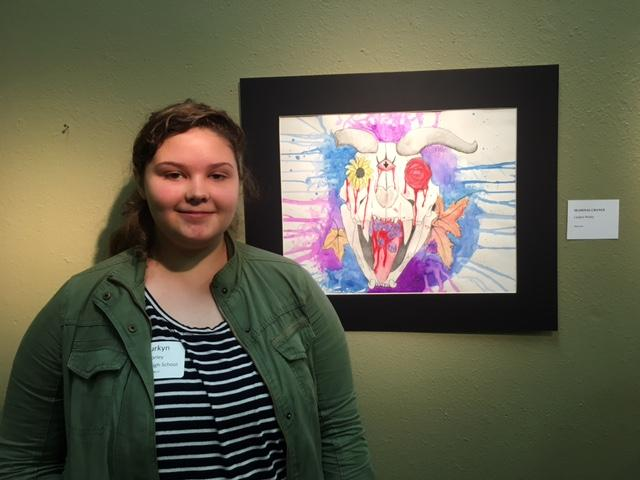 Freshman Laurkyn Worley in front of her piece. She was honored by Representative Louie Gohmert in the Congressional Art Competition.