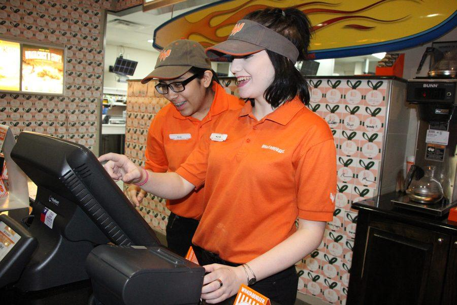 Juniors Juliee Acosta and Isabella Weitzel working at Whataburger