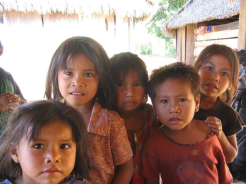 Young children from Peru pose for a picture.