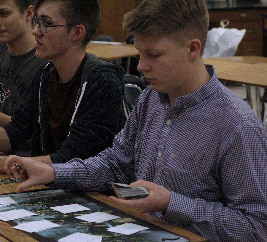 Coleman Allen plays a trading card game.