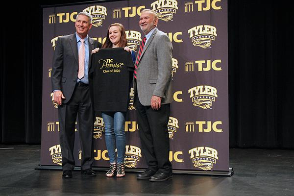 Juliette Wood stands next to superintendent Stan Surratt and TJC President Dr. Mike Metke during TJC promise ceremony. The ceremony included dozens of students from the graduating class of 2020.