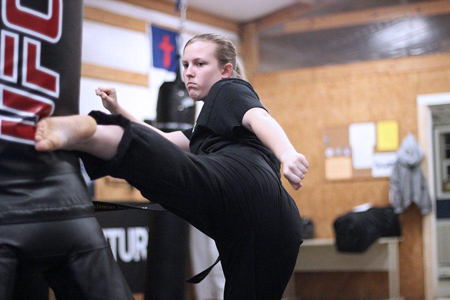 Hannah+strikes+the+bag+with+a+mid-kick