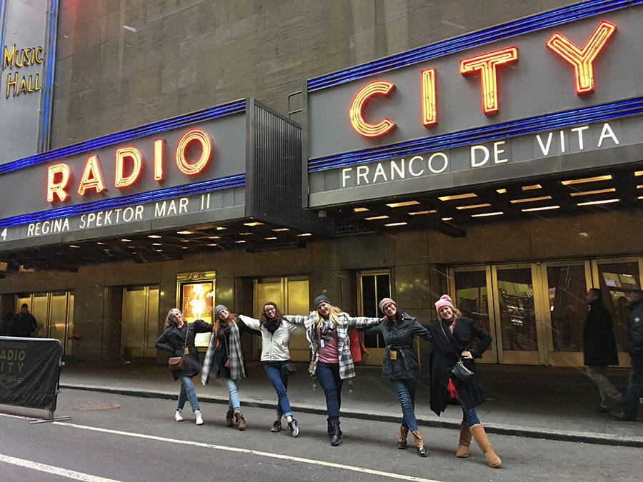 Star Steppers pose like Rockettes outside Radio City Music Hall.