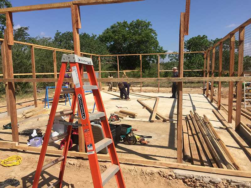 Building crew labors to finish the structure for their new church. Lindale student Bryan Edwards took part in this process for a week.