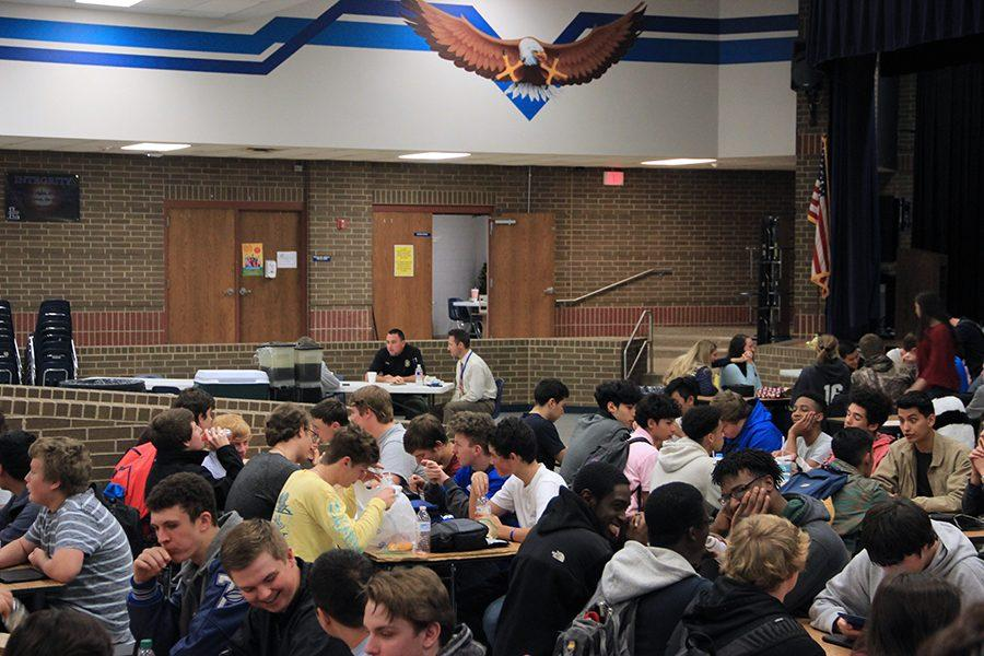 Students eat lunch in the area of the cafeteria they are permitted to sit in.