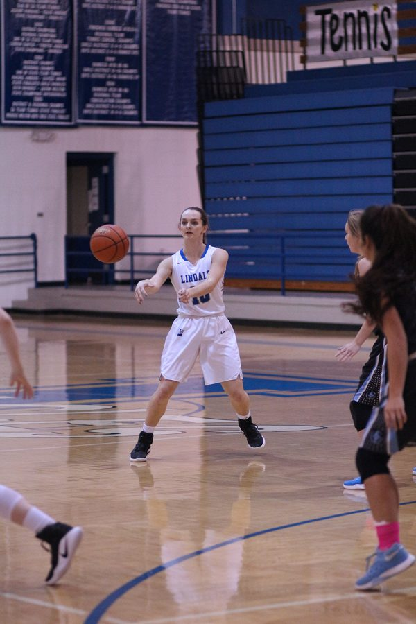 Junior Alisha Kiser making a pass to her teammate in the game against Union Grove.