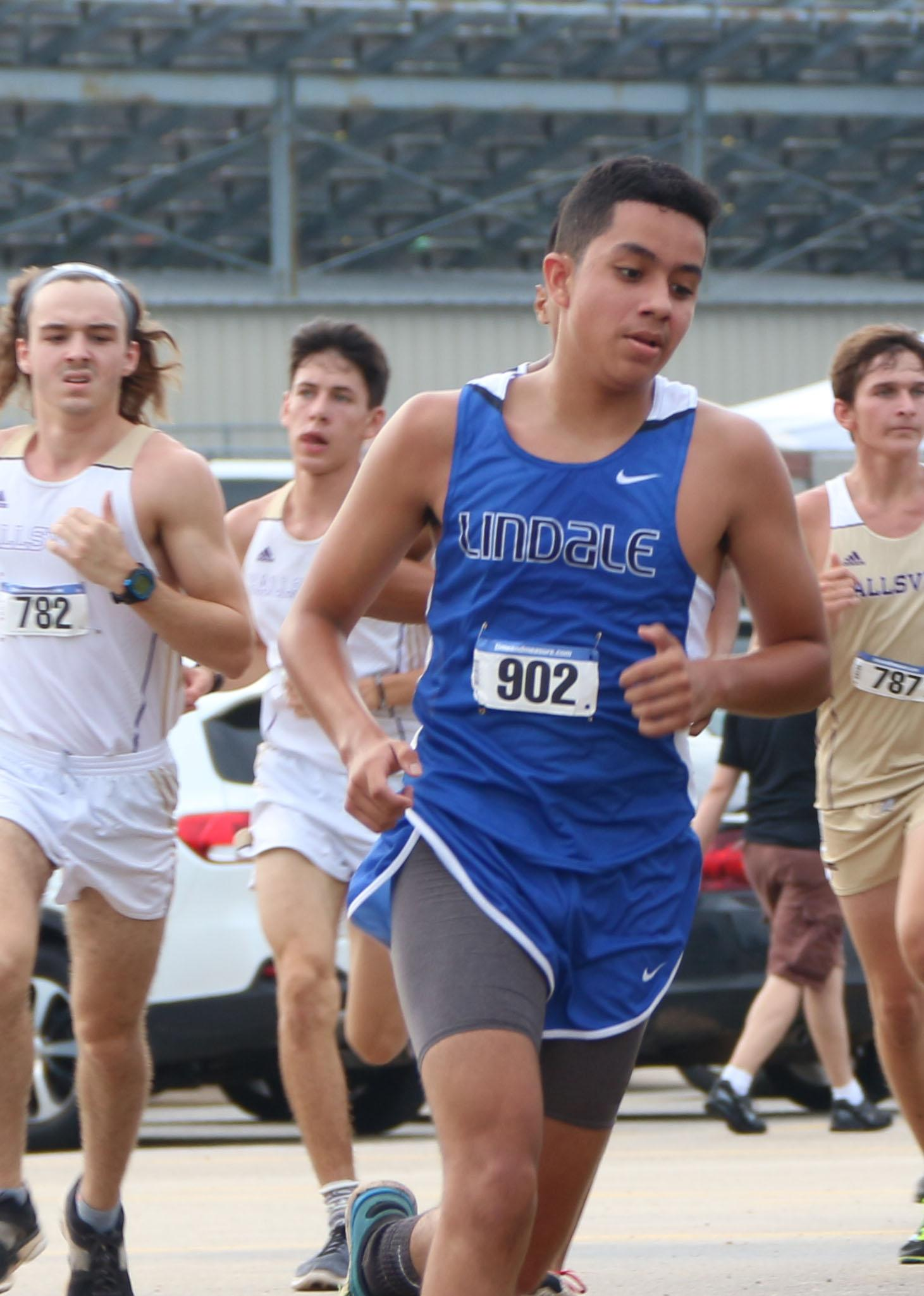 Senior Alan Ramirez comes around the corner during a cross country meet.