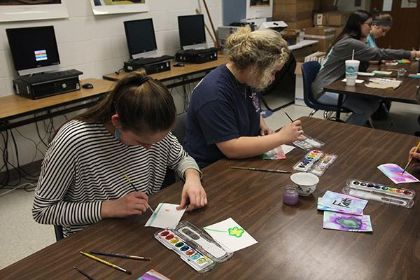Students work on painting projects in Mrs. Harrison's art class.