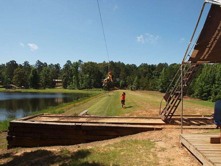A+camper+enjoys+the+zipline+at+Timberline+Baptist+Camp+and+Conference%2C+owned+and+operated+by+the+family+of+sophomore+Austin+Roots.