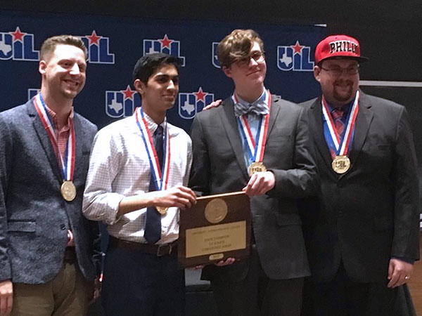 Junior Ronak Desai and Senior Jonas Thrasher-Evers celebrate their UIL State championship with coaches JP Fugler and Rory McKenzie. The teachers have coached individuals and teams to state championships already this year.