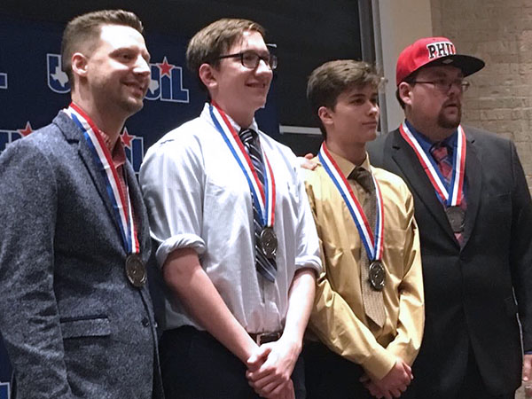 Juniors Robert McWhorter and Anthony Wyatt celebrate placing second at UIL State with coaches JP Fugler and Rory McKenzie.