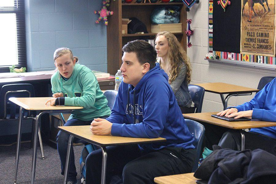 Junior Nathan Henson listens intensively in class. Henson was recently featured in the Tyler Today Magazine and is currently writing a sports-romance novel.