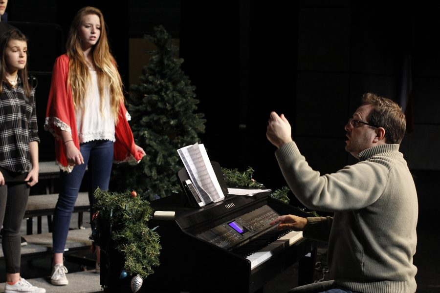 Halbgewachs teaches student from behind a piano.