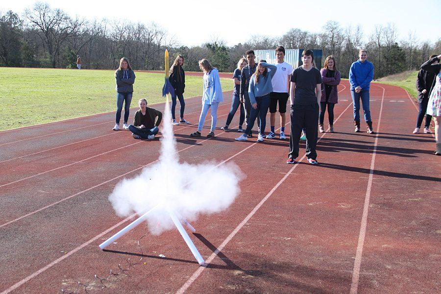 Students+watch+as+the+rocket+successfully+shoots+into+the+air.+