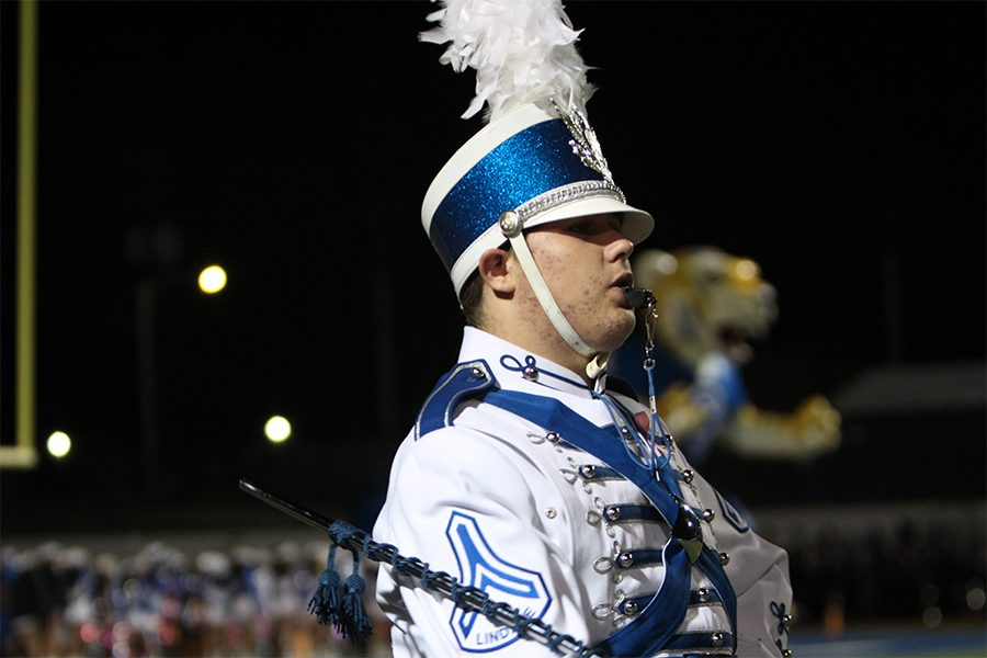 Sophomore of the year and drum major Hayden Nicholson directing the band during the Corsicana varsity football game.