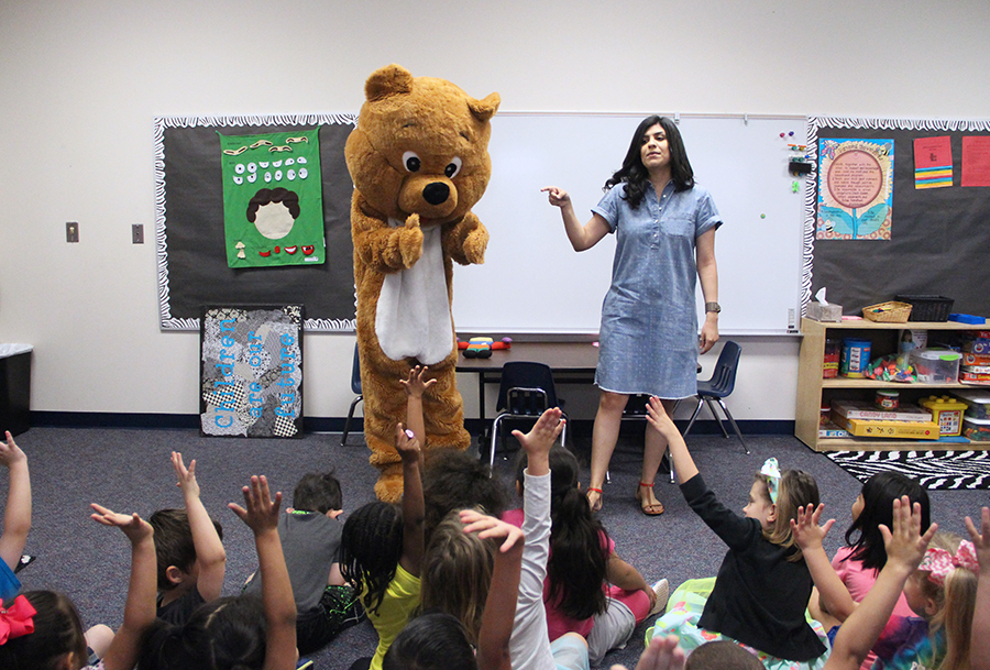Kayleigh Melvin performs in  Happy Bear costume for kindergarten students. She put on the skit for the students on Wednesday.