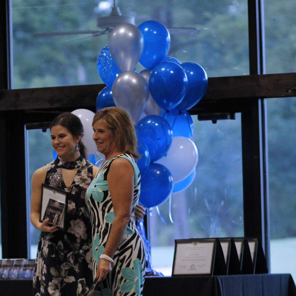 Kelsi Kilgore and the teacher she selected, Pamela Price, receive honor at the banquet. Kilgore was fifth in her class this year.