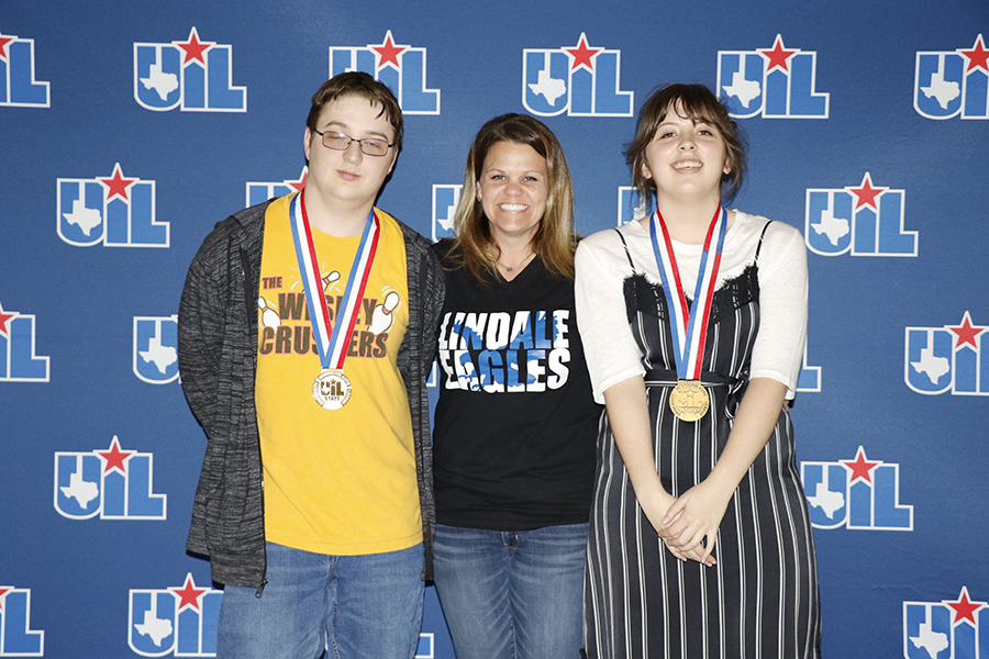State qualifiers Skylore Evans and Kelsi Jones pose with coach Amanda English after being rewarded medals. Both students worked for many hours to be honored for their academic success.