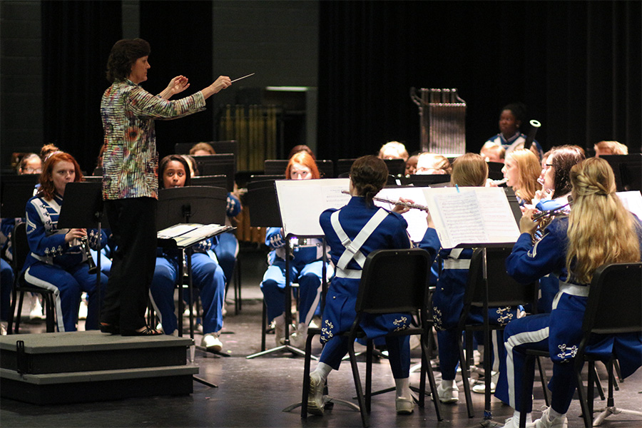 Symphonic band director Susan Scott directs her band during the pre-UIL concert. Scotts band was awarded a score of one from every judge at contest.