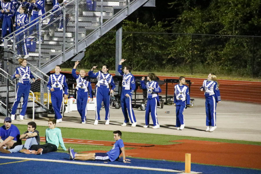 Percussionists dance and hold up their