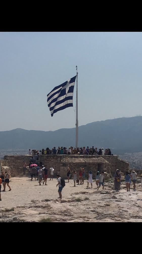 A Greek flag waves in the wind. Lindale students ventured through Greece on a study abroad program this summer.