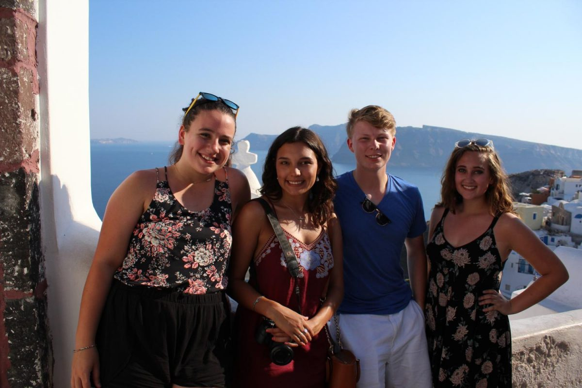 Addison+Baquet%2C+Morgan+Droblyn%2C+Coleman+Allen%2C+and+Julia+Austin+stand+with+their+backs+to+a+Greek+coastline.+The+students+viewed+these+stunning+vistas+as+the+travelled+across+the+Mediterranean.+