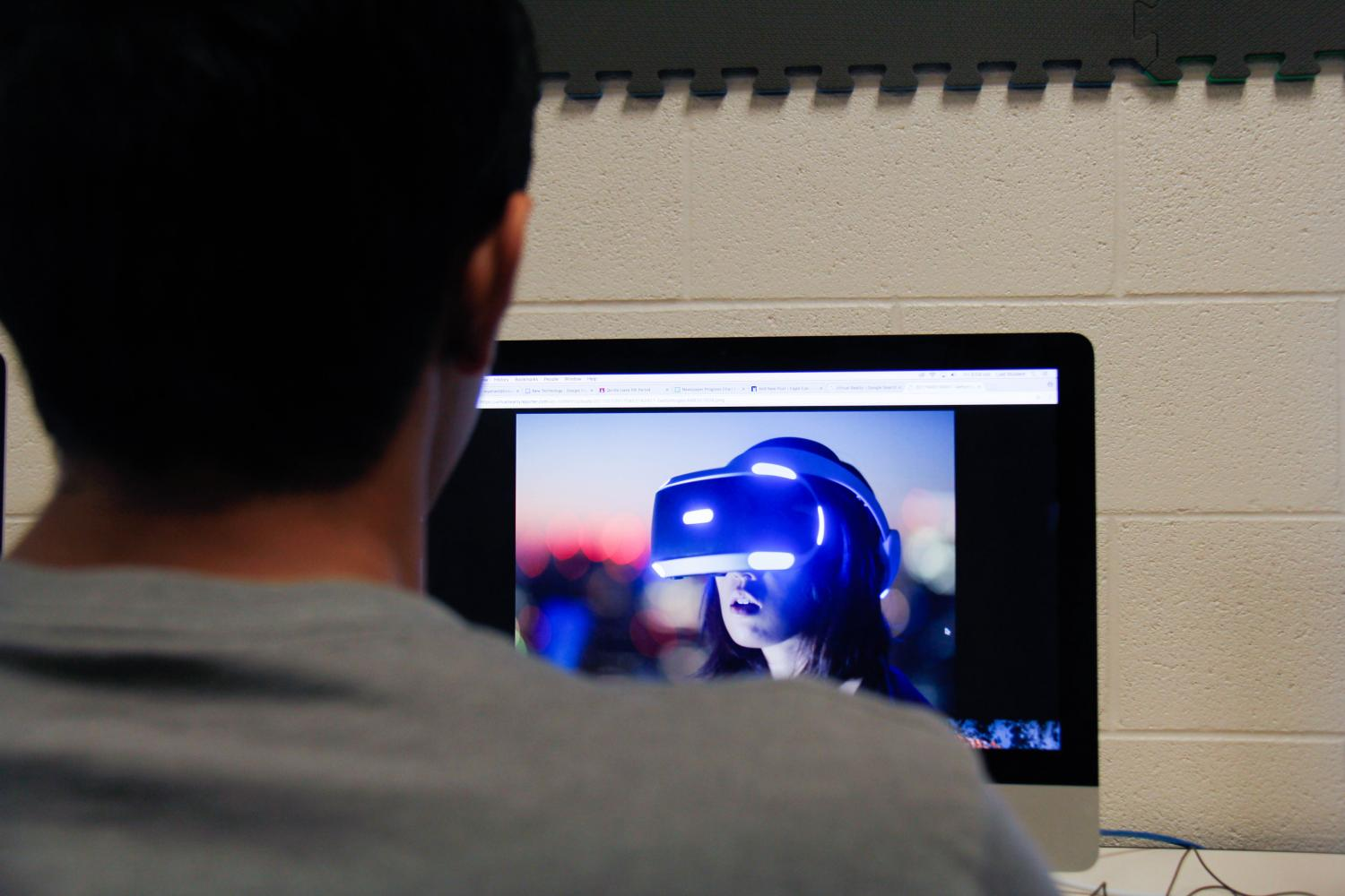 Senior Ronak Desai views the latest virtual reality technology. Virtual technology has the advanced capability to immerse a user into a three dimensional world.