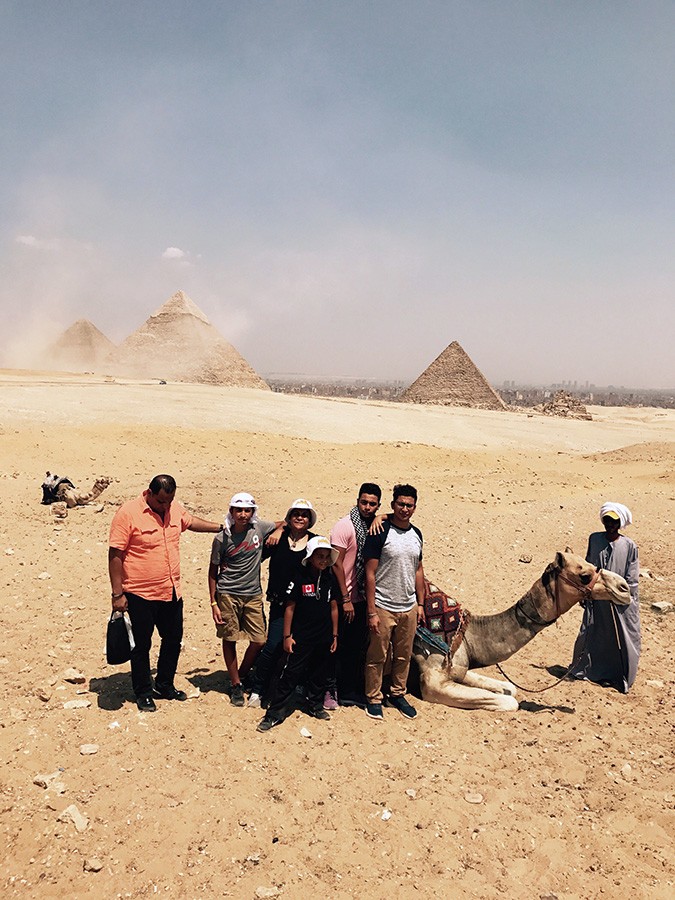Gihan+Boulues+and+her+family+pose+in+front+of+the+Pyramids+of+Giza.+Boules+and+her+family+spent+the+entire+summer+there+after+not+returning+to+Egypt+for+seven+years.