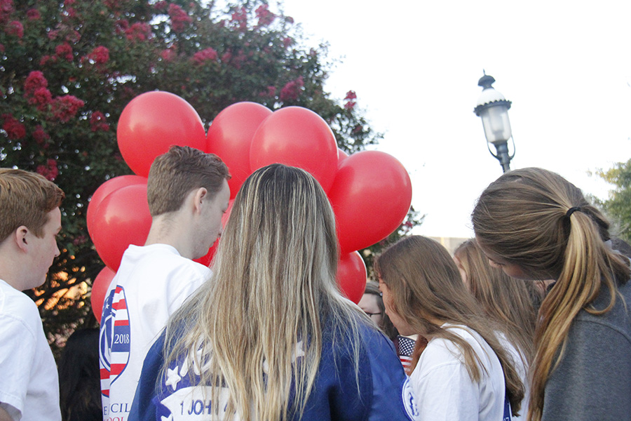 Student council members each take a balloon with the name of  9/11 victim written on a tag tied to the bottom. All the balloons were later released into the air similtaniously as snare drums played in the background.