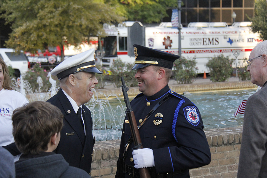 Former fireman, Joe Yeakley laughs as he talks with a Tyler police officer. Mr. Yeakley is a well known Lindale hero who survived being badly burned after fighting a house fire.