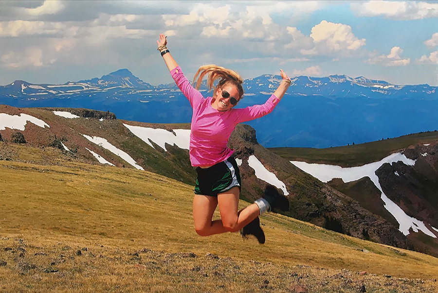 Senior Adrienne Parks jumps for joy on peak day of her hike through the San Juan Mountains. A group from Lindale First Baptist Church spent a week backpacking in Colorado.
