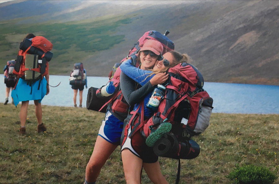 Senior Adrienne Parks and alum Elizabeth Warren hug by an alpine lake at 12,000 ft elevation. All the girls on the trip made friendships to last a lifetime.
