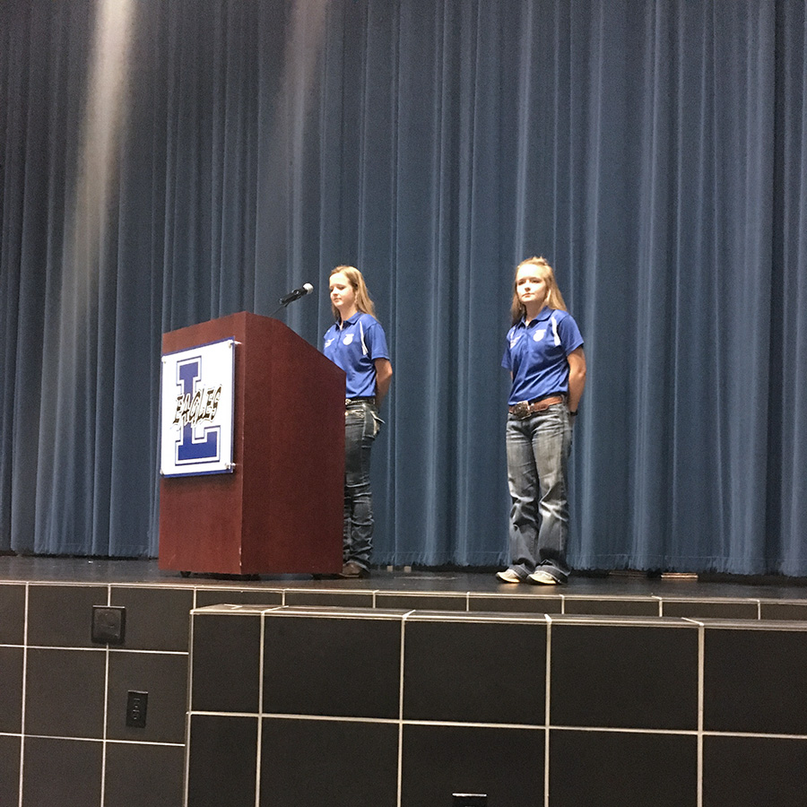 Senior Ashlie Thompson and junior Laramie Wedemeyer give a speech at the chapter meeting.