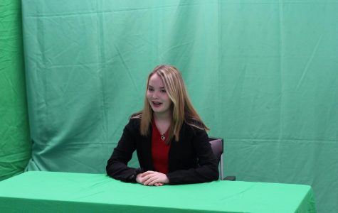 Junior Kaylee Rodriquez delivers the news for the first broadcast. The class planned and prepared for weeks before the filming.