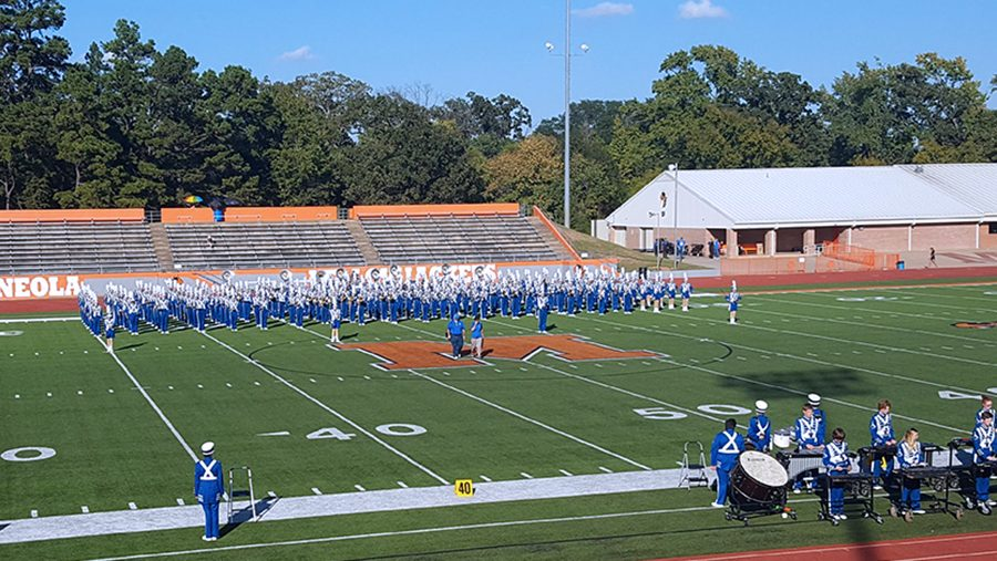The band prepares to perform at the Mineola Marching Band Festival. Lindale was the only military band to advance to finals, ultimately placing fifth overall.