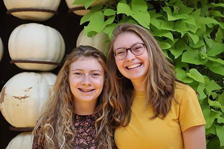Joy and Hope Nelms pose for a photo together. This is the first year for the sisters to be in high school together.