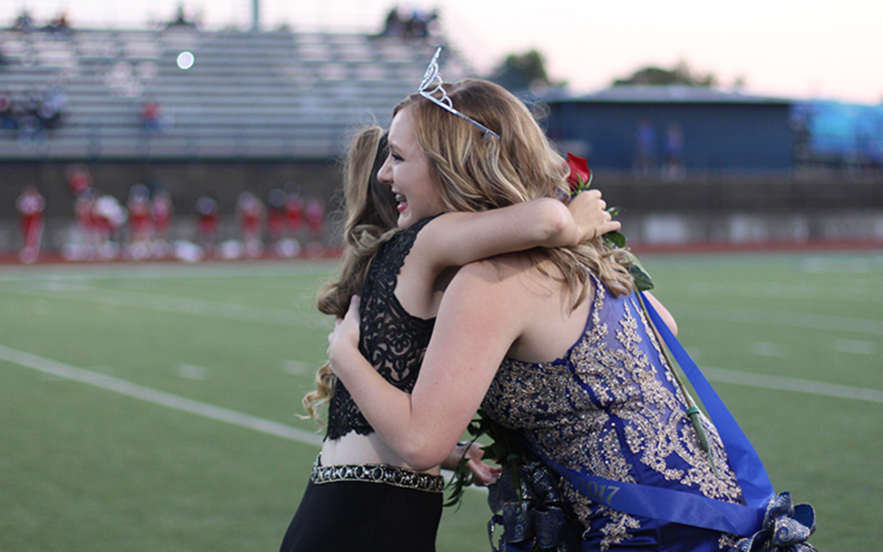 Homecoming queen Klaire Hicks hugs fellow queen nominee Adrienne Parks.
