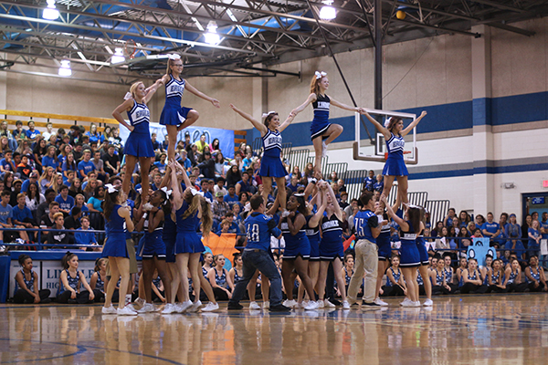 (From left to right) Seniors Ty McDaniel and Justin Little assist Crista Hudspeth and Jasie Ross in their routine. Seniors Thomas Olsen and Conner Heller also assisted the cheerleaders during their homecoming performance. A special appearance was made by Alex Wilson who tumbled along side the cheerleaders.