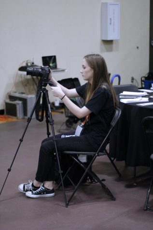 Sarah Huseth recording a segment for the Yamboree documentary. Huseth is involved in Audio Visual, Band and Yearbook.