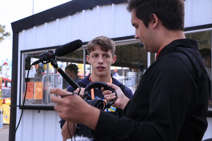 Sophomore Gabriel Ledesma and Senior Zac Brooks filming at the East Texas Yamboree. Ledesma and Brooks worked as the sound operators for the crew.