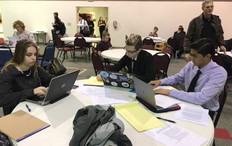 Debate team members prepare for contest at the Regional Meet for Congressional Debate. Lindale students placed first through fourth at the competition.