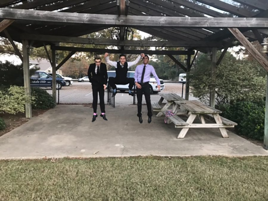 Seniors Evan Bewersdorf, Anthony Wyatt, and Ronak Desai jump for joy at the Regional Meet for Congressional Debate. All three students advanced to state.