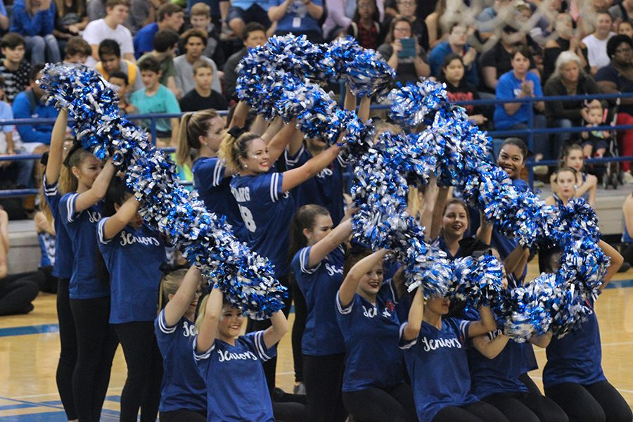 The drill team dances to their routine during the pep-rally. At the end, the senior formed an '18 for their graduating year.